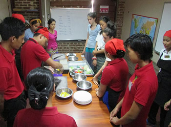 Cooking demonstration for the students from the USA by students from Sanon